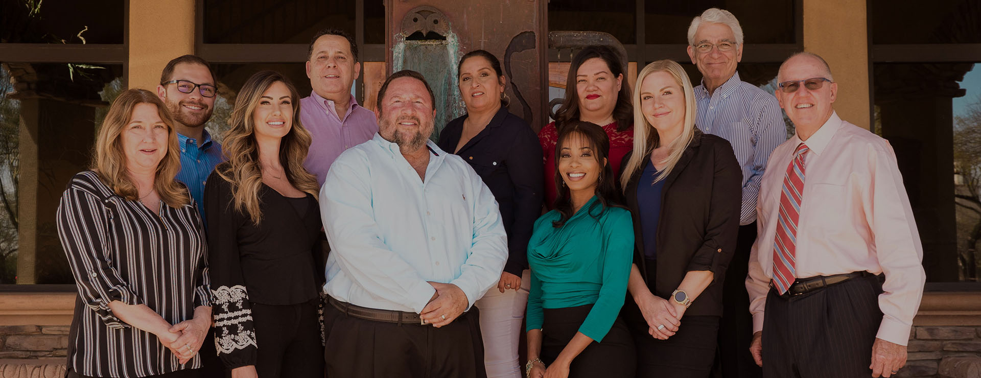 Greenberg Financial Group's team members are standing.