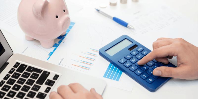 Man using calculator to create budget