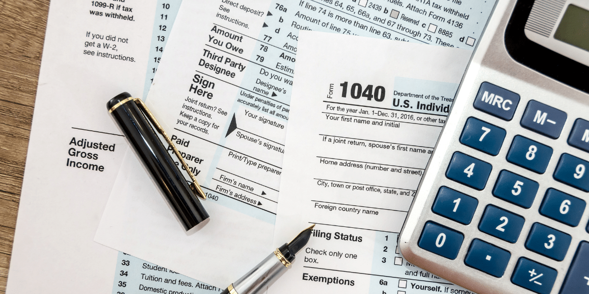 1040 tax forms and a calculator